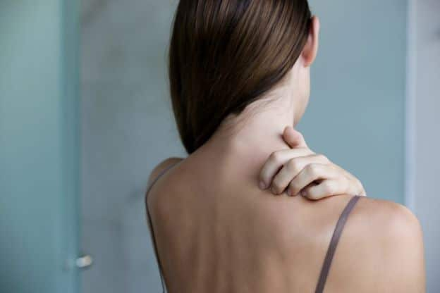 woman with dry skin due to hard water